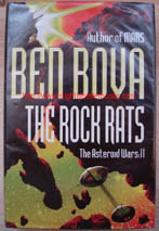 Bova, Ben. 'The Rock Rats: The Asteroid Wars: 2', published in 2002 by Hodder & Stoughton in hardback, with dustjacket, 440pp, ISBN 0340769580. Condition: Good, clean ex-library copy with some library markings; and a plastic cover protecting the exterior of the book. Price:£3.50, not including p&p, which is Amazon's standard charge (currently £2.75 for UK buyers, more for overseas customers)