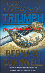 "Cornwell, Bernard. ""Sharpe's Triumph"" published in 1999 in paperback, 382pp, ISBN 0006510302. Condition: good condition, well looked-after copy, with a crease to the lower right corner on the front cover and some slight rubbing to the cover corners and edges. There is a touch of foxing to the long opening edge of the book, in the form of an orangey yellowy mark (hardly noticeable). Price: £3.75, not including post and packing"
