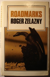 Zelazny, Roger. 'Roadmarks', published in 1981 by The Science Fiction Book Club, in hardcover with dustjacket, 192pp. Sorry, sold out. Click image to access prebuilt Amazon search for this title!